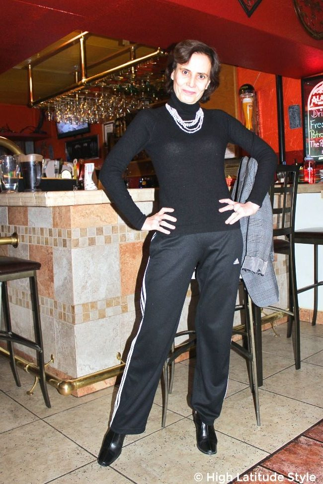 #midlifestyle mature woman in gym pants and turtleneck sweater