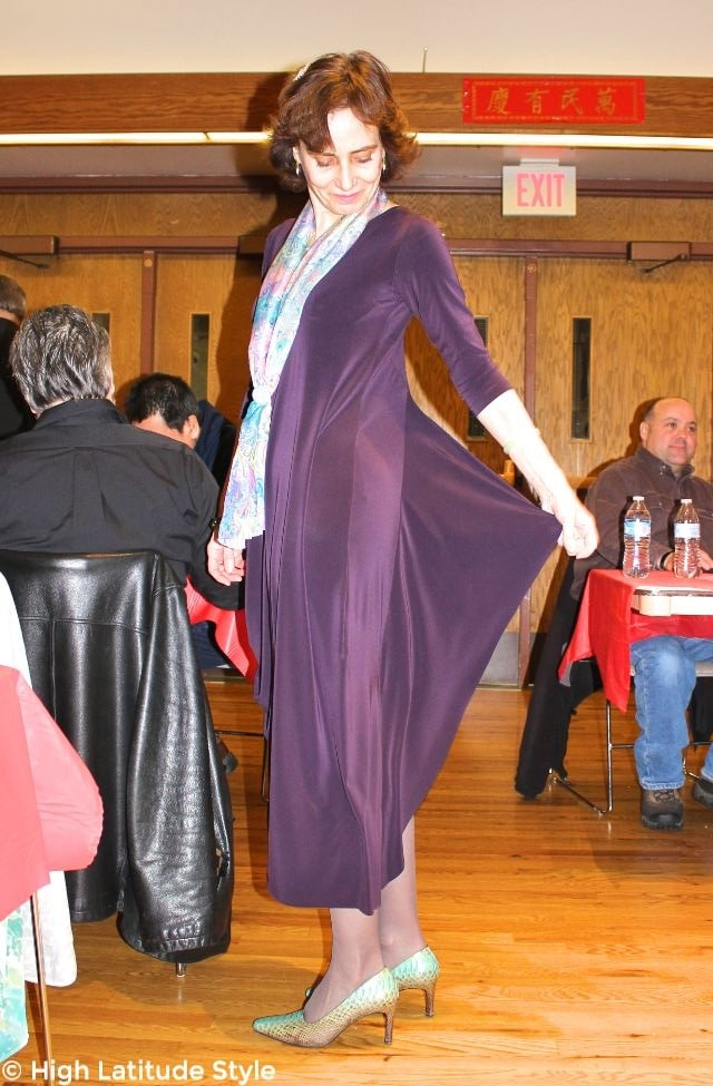 #advancedstyle woman in purple dress with light green pumps