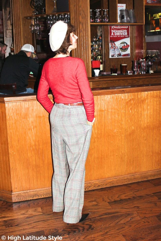 #fashionover50 woman looking posh chic in a sweater with high waisted plaid pants look