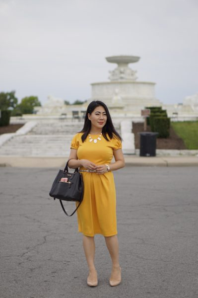 blogger Grace Liang in a yellow summer dress for continental humid weather