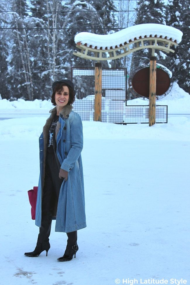 midlife blogger looking posh in street chic in the snow wearing denim coat, leather beret and joggers
