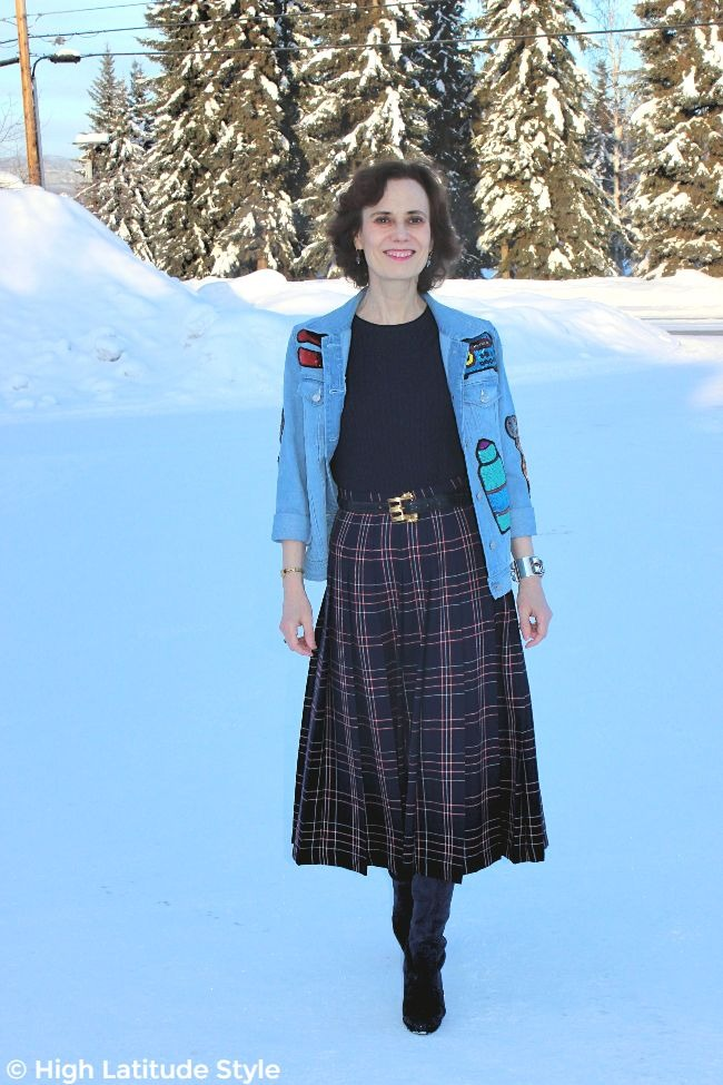 #midlifefashion mature woman in street chic with edgy sequin patched denim jacket and plaid pleated wool skirt