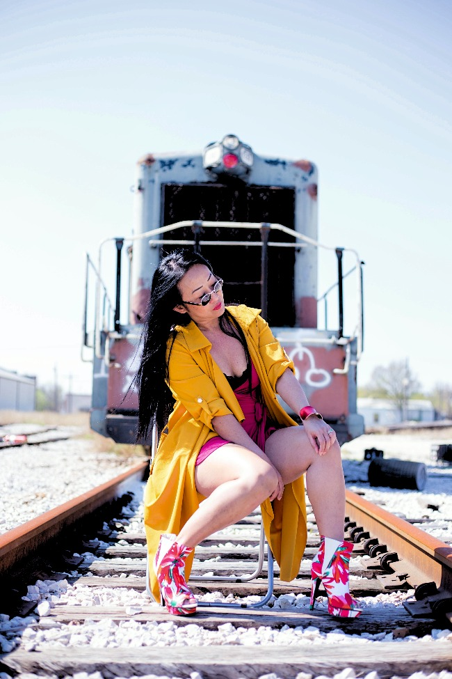 #styleover40 40+ woman in an eclectic street style in yellow, red, black and white in front of a train