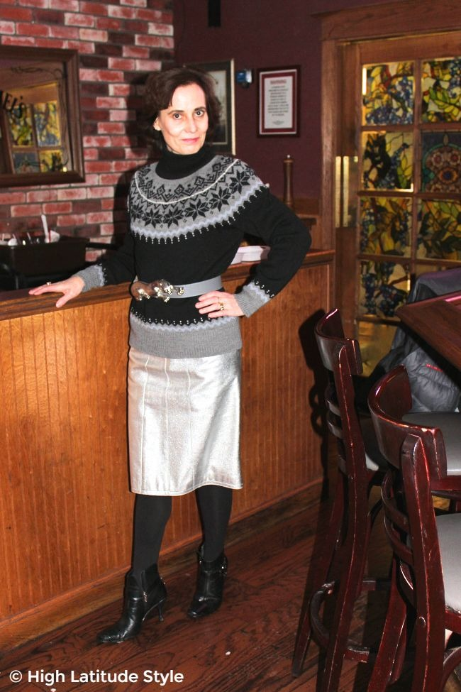 #agelessstyle Alaskan woman in silver skirt with Fair Isle sweater and panther statement belt in spring