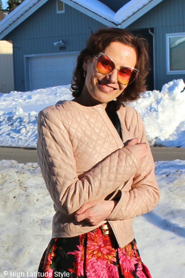 #fashionover50 midlife woman looking posh in quilted jacket, floral skirt and Ed Hardy glasses