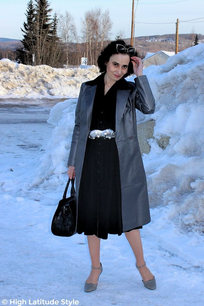 #fashionover50 blogger looking trendy with specs in her hair, trench coat, shirt dress office look