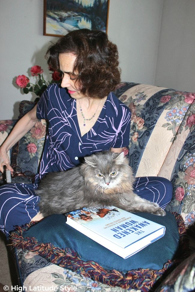 #HomeIsTheKey #somaintimates woman in PJs at home with cat and book