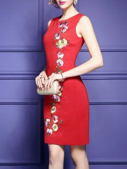 Petite friendly sleek sheath dress with floral embellishment
