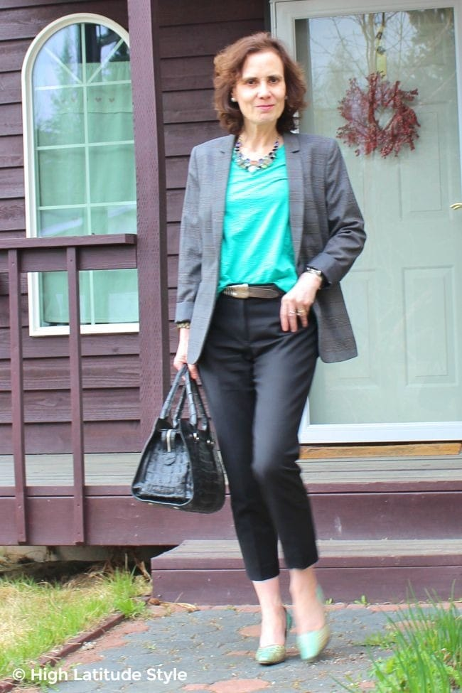 #styleover50 woman in gray, black and teal work outfit of shirt, pumps, pants, and
