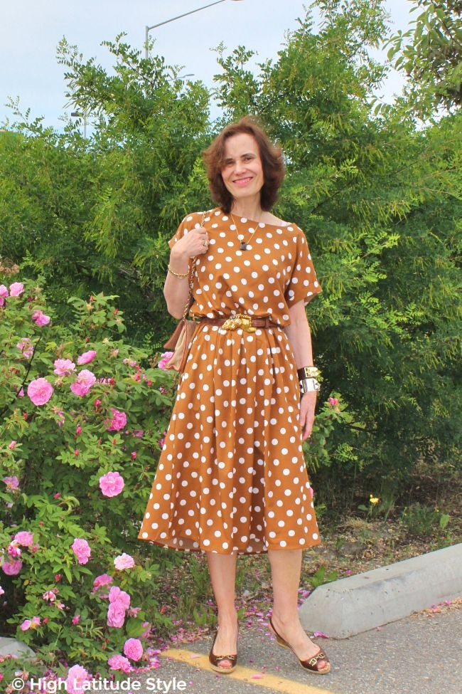 #fashionover50 midlife woman in iconic copper brown with white polka dot dress