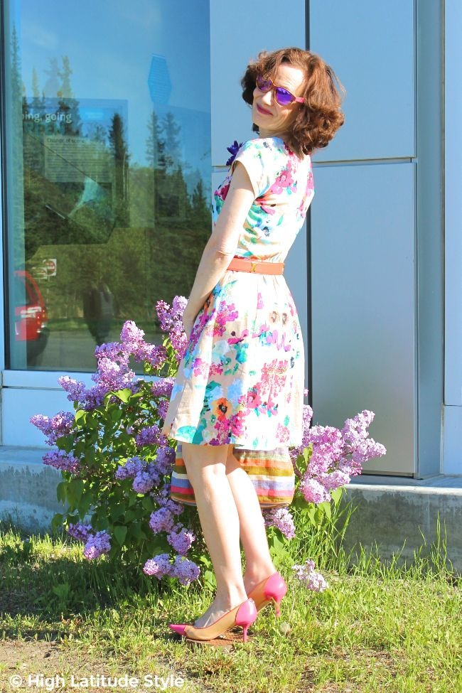 #midlifestyle lady in floral fit-and-flare summer dress with purple mirrored wood sunnies