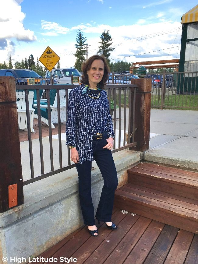 midlife fashion blogger in relaxed casual outfit with trousers and plaid blouse half-tucked