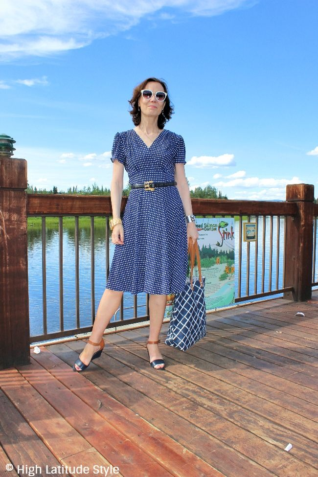 fashion blogger in tan, navy and blue outfit with plaid, polka dots and stripes