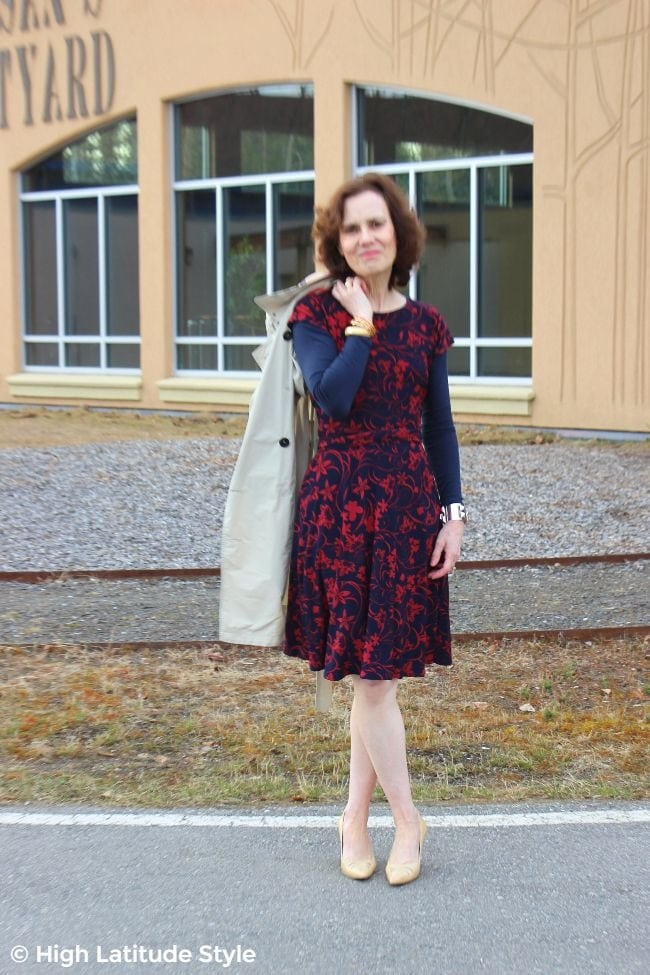 #fashionover50 midlife woman in floral dress with pointy toe heels and trench coat