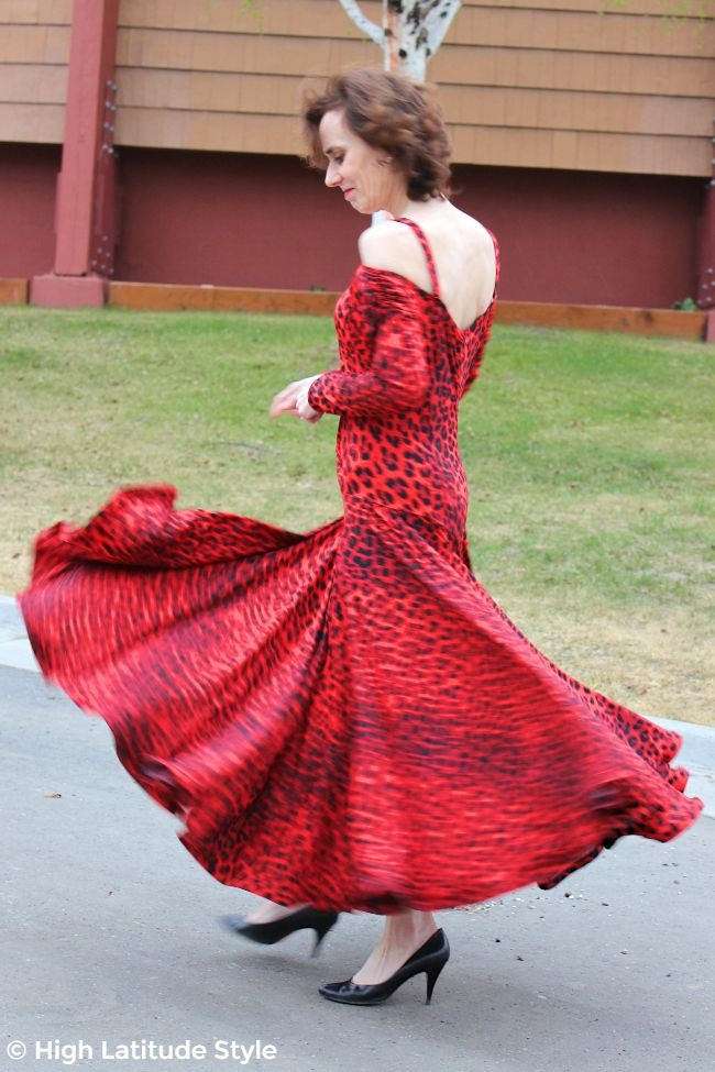 mature woman twirling in a lean dance costume with wide twirling skirt