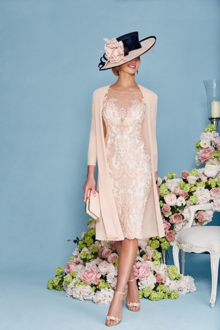 #weddingstyle #angrila_dress woman in a British inspired mother-of-the-bride dress with coat and hat