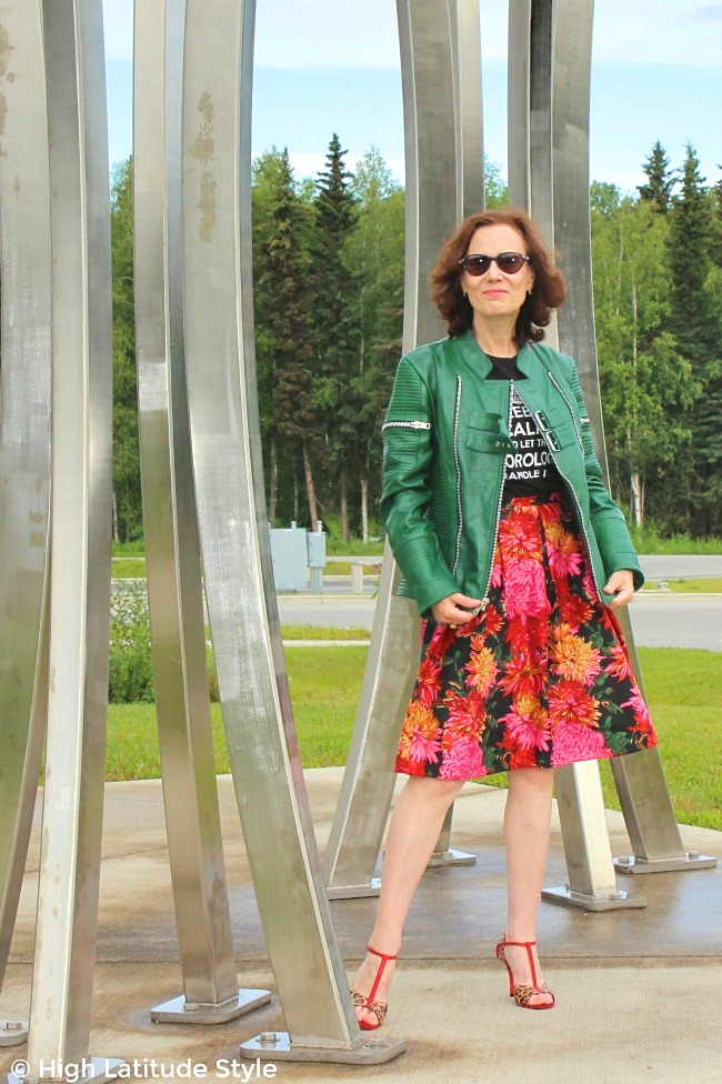 #fashionover40 older women in edgy classic outfit of biker hide, full skirt, graphic T-shirt and T-strap sandals