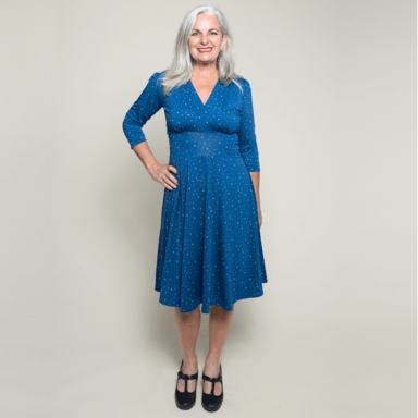 #fashionover50 woman in blue dress with Milky Way inspired print