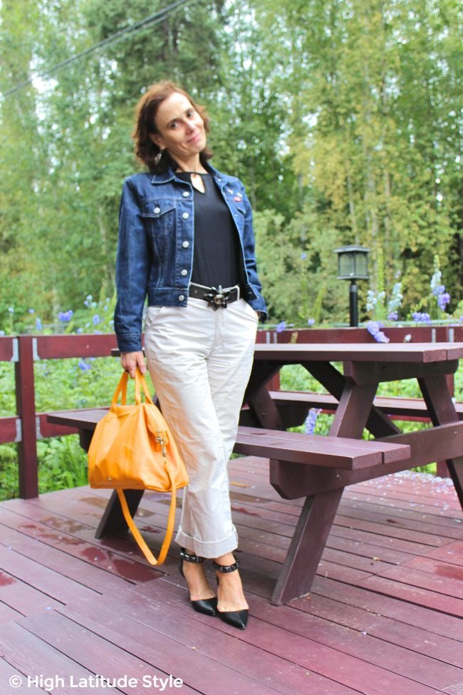 #midlifestyle woman in chinos, jean jacket, statement pumps and belt plus tear drop whole top