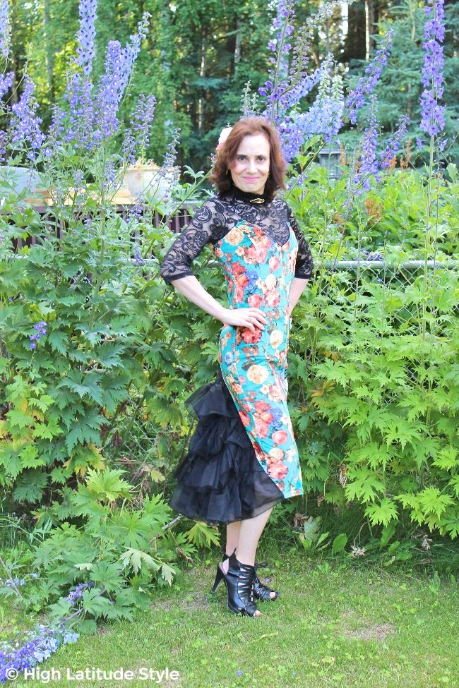 #fashionover50 older woman in a dance dress with floral print, lace and tail