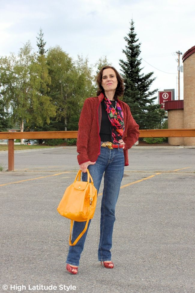 #advancedstyle midlife woman looking casual posh in a #WhistleRiver zipper-jacket, jeans, sweater, scarf and heels