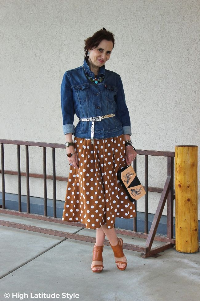 mature woman in polka dot dress with denim jacket fall wardrobe