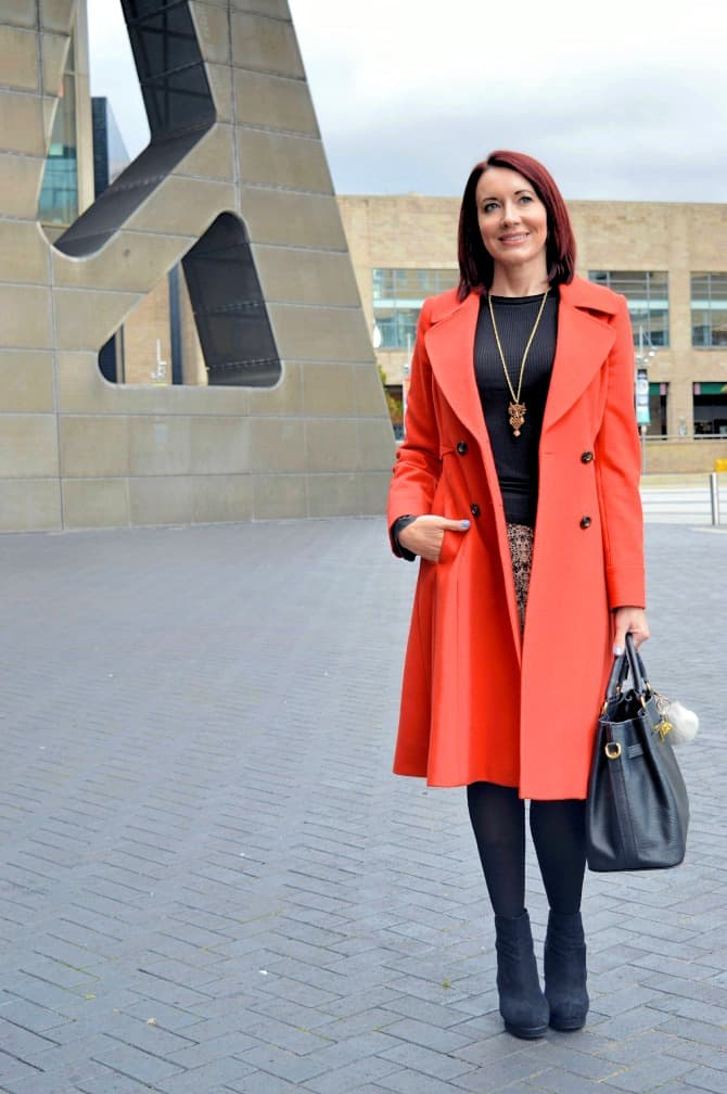 Top of the World Readers' Fav Emma of Style Splash in a statement orange coat