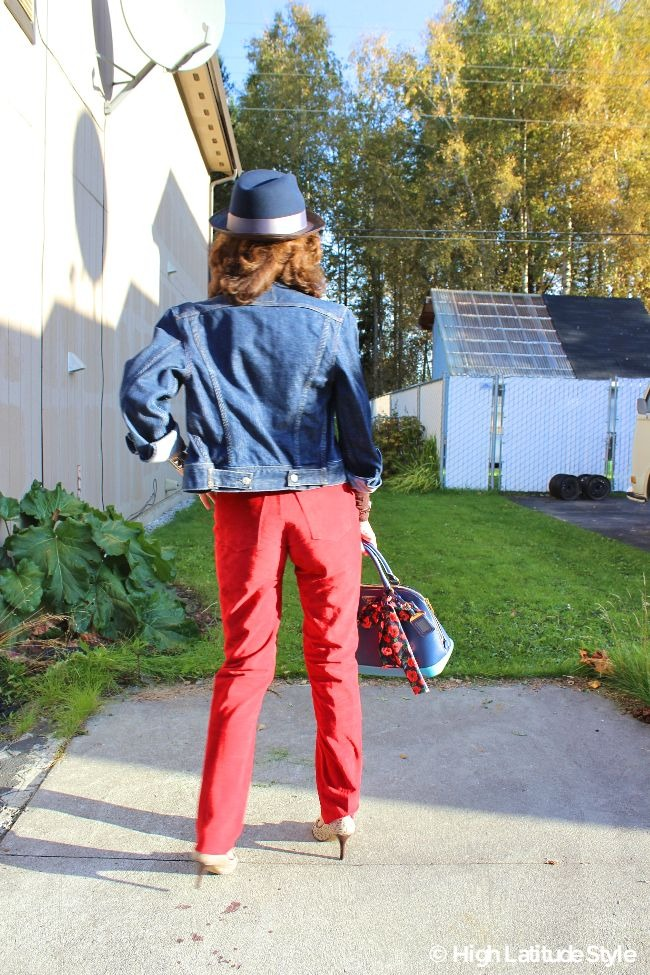 #fashionover50 lady in red, brown and blue fall outfit with Santana Katmandu hat