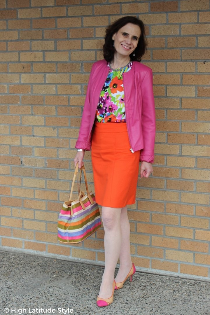 blogger Nicole in fake suit with floral top striped bag and pumps