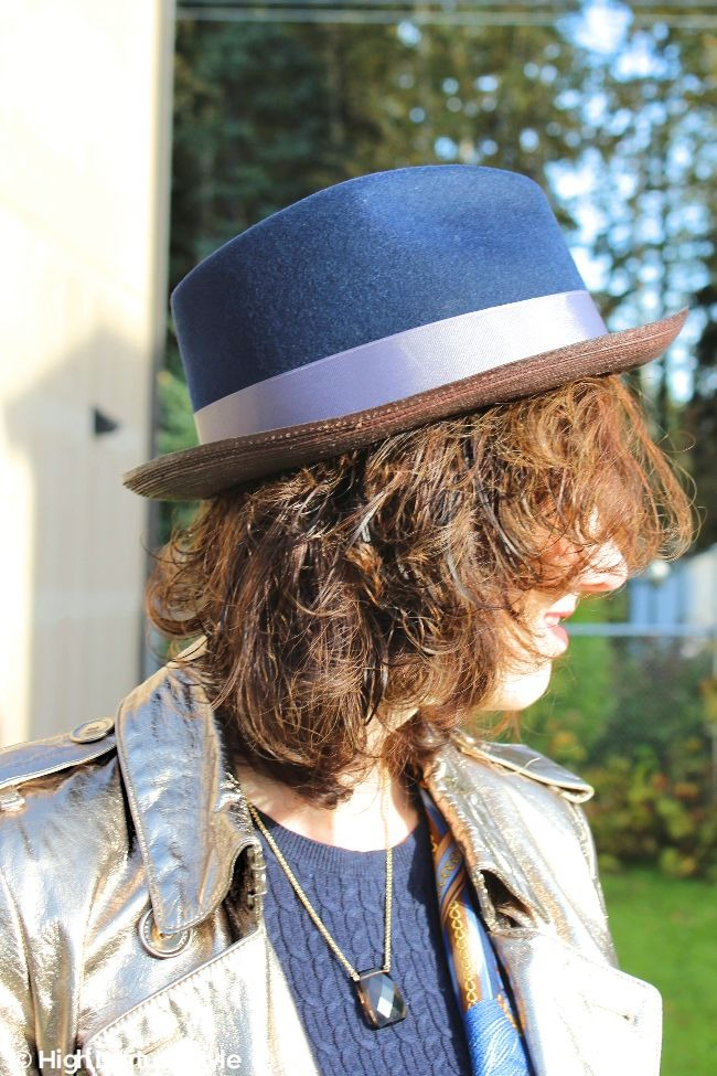 #advancedstyle woman wearing a mixed materials fedora