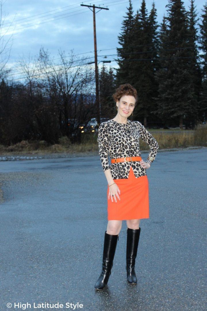 Nicole of High Latitude Style in leopard cardigan and orange skirt