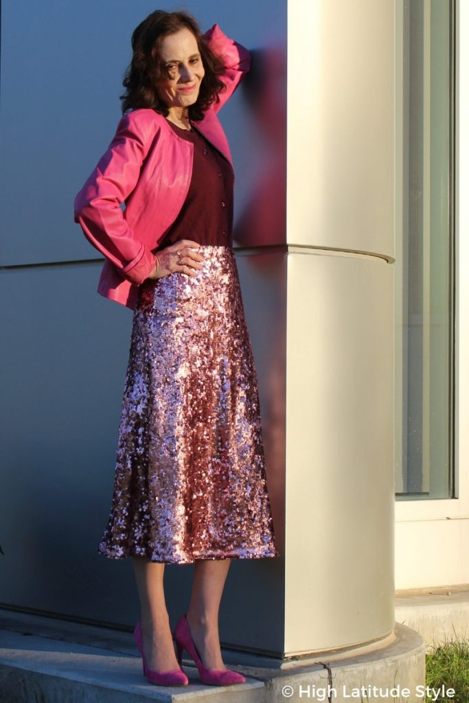 Nicole of High Latitude Style in shades of different depth from burgundy to pink with sequin skirt, leather jacket, suede high heels, and button front top