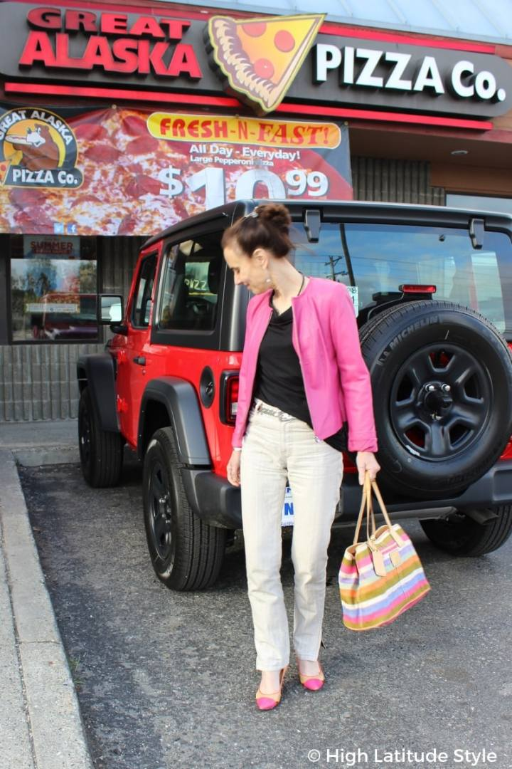 #fashionover50 High Latitude Style in a pink leather jacket in front or a red car