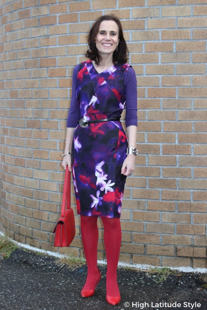 style blogger in purple print sheath, red tight, pumps, and bag
