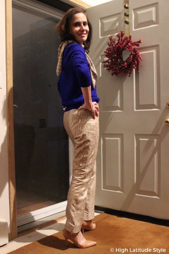 #chicover50 midlife woman in snake print pants, royal blue sweater and nude heels