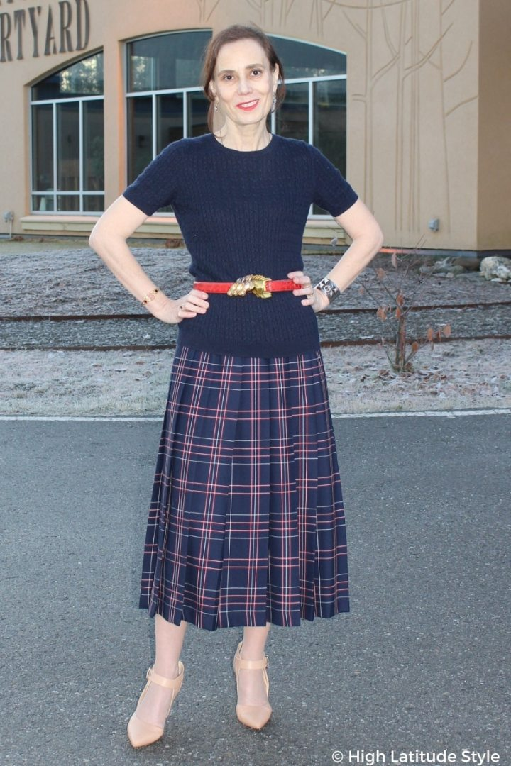 #over50fashion style blogger Nicole donning a fall style office look with plaid skirt, matching top and belt