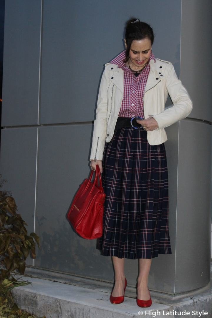 street chic style blogger in plaid pattern and biker jacket