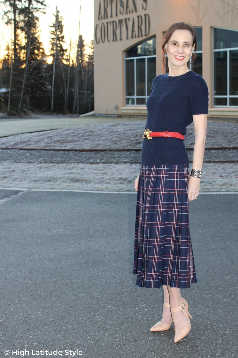 Nicole of High Latitude Style in midi skirt, heels, updo and belted cashmere top