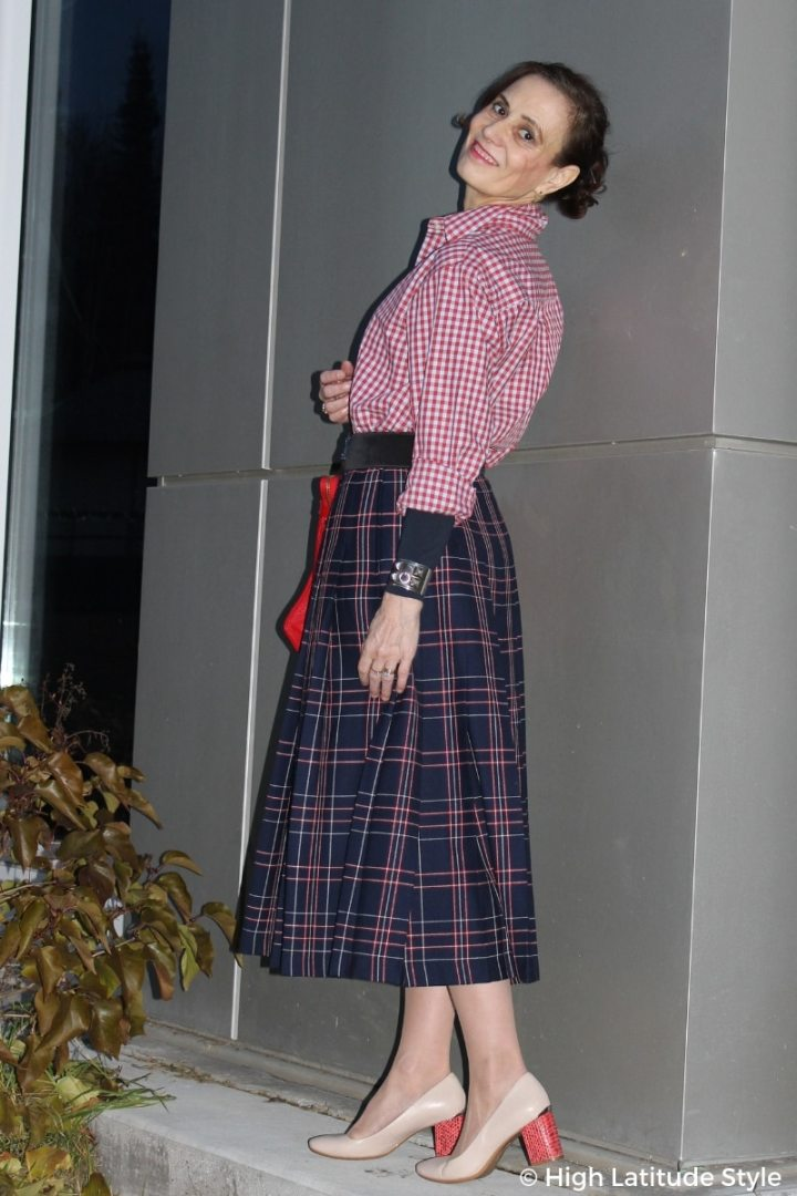 #maturestyle Nicole in gingham blouse, plaid wool skirt, block heel shoes and statement cuff