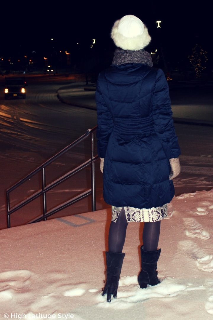 #fashionover40 woman in a gray blue outfit standing in the snow