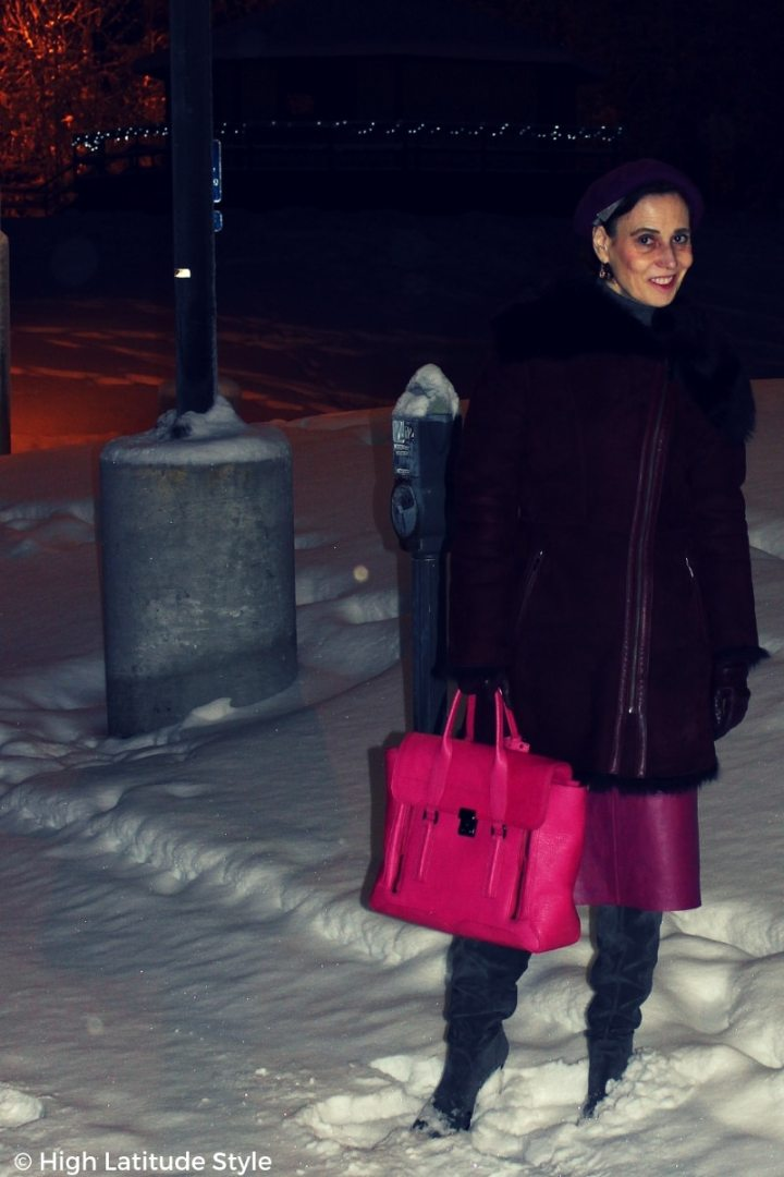fashion blogger Nicole standing outside in burdgundy, pink and gray outerwear winter style
