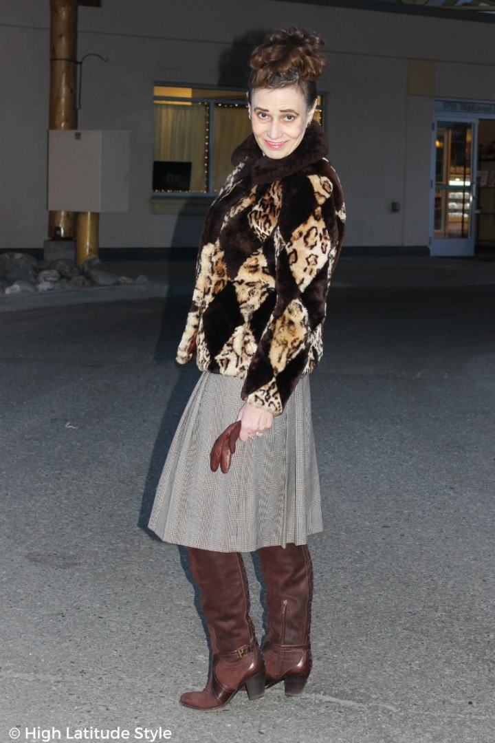 #fasionover50 Nicole wearing a skirt, otk boots and winter outerwear