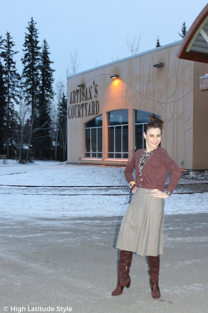 mature woman in winter office look with leopard print, cardigan, glen check skirt, suede boots