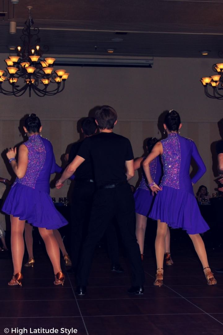young dancers in trendy purple assymmetric costumes