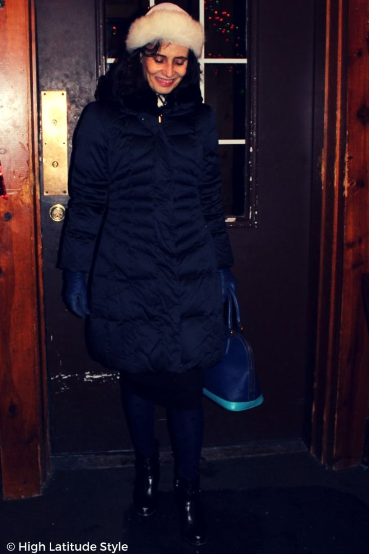 #winterstyle Fashion blogger in winter outerwear with hat, tights and booties