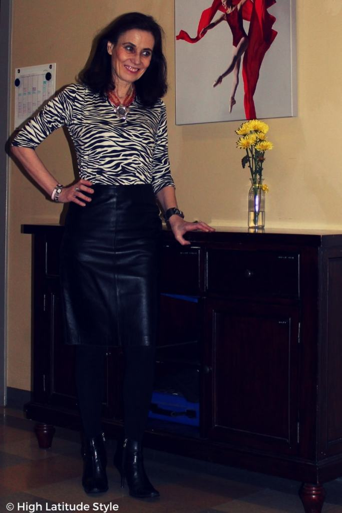 mature fashion blogger with animal print tee and leather skirt