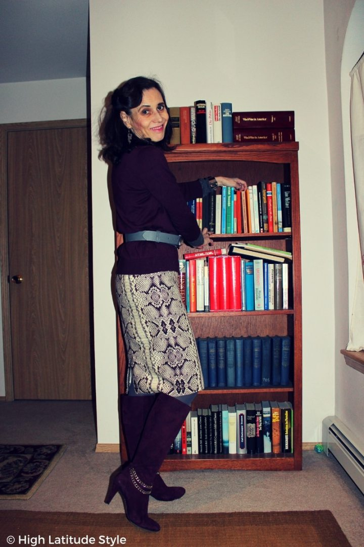 mature style blogger in trendy business casual winter outfit with skirt, boots, faux twinset