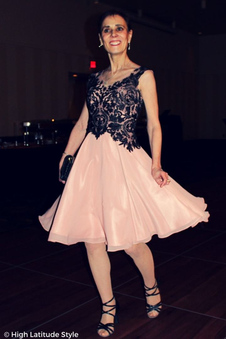 Style blogger in nude black ball gown