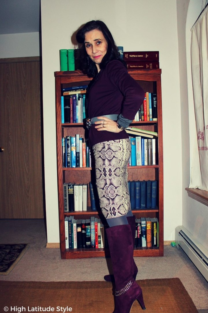 fashion blogger Nicole donning the snake print trend in a business casual winter work outfit with tall boots, cardigan and sweater