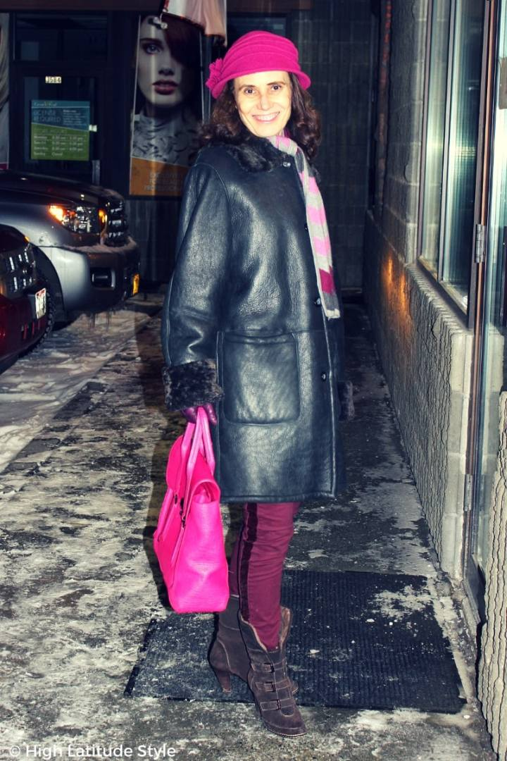 Nicole of High Latitude Style in shearing coat, purple hat, jeans bag and hat #TenthStreet #maturestyle